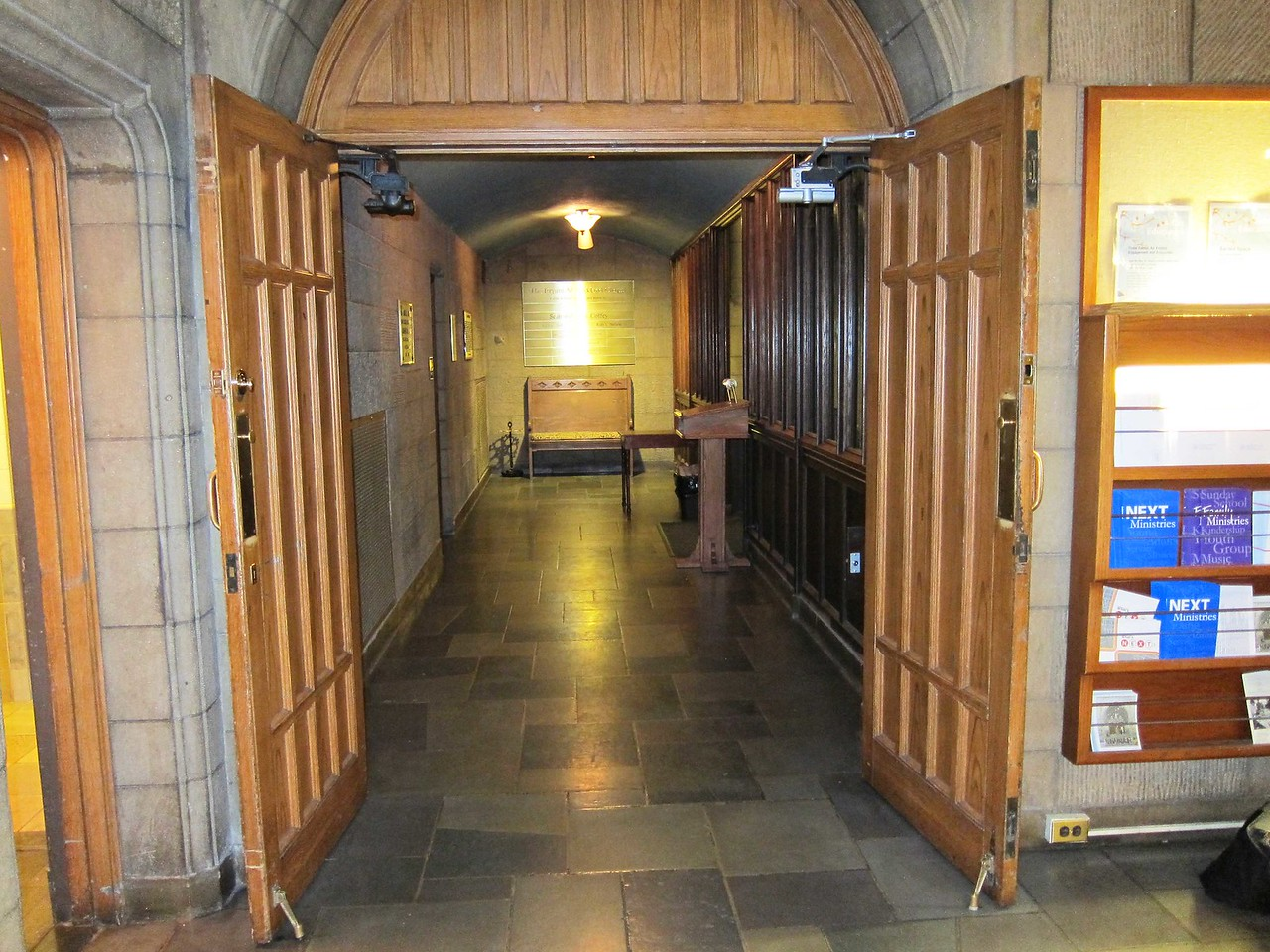 The vestibule of the Chapel seen from the main lobby off 7 W. 55th Street. To the right is the elevator bank; to the left are small restrooms for men and women. Behind the photographer is the receptionist's cubicle.