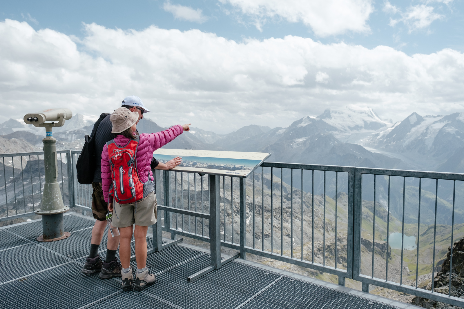 Tourists pointing at the horizon at Mont Fort Verbier