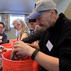 Growing Places in Leominster held a vermicomposting basics class on Saturday, February 9, 2019 at The Doyle Room at the Doyle Conservation Area in Leominster. Vermicomposting, or composting with worms, can be done in a worm bin in the comfort of your home. Participant in the class Larry Gianakis of Leominster puts in some wet paper as he builds his worm bin to take home during the workshop. SENTINEL & ENTERPRISE/JOHN LOVE