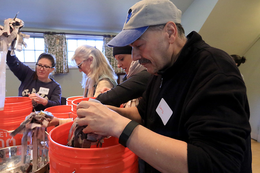 . Growing Places in Leominster held a vermicomposting basics class on Saturday, February 9, 2019 at The Doyle Room at the Doyle Conservation Area in Leominster. Vermicomposting, or composting with worms, can be done in a worm bin in the comfort of your home. Participant in the class Larry Gianakis of Leominster puts in some wet paper as he builds his worm bin to take home during the workshop. SENTINEL & ENTERPRISE/JOHN LOVE