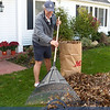 Alex Staneff taking advantage of the great weather raking leaves.