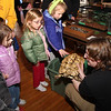 Jenna Peters is gently petting the turtle, held by sarah Langdon, from Back To The Wild employee. Looking on, are: Ethan Roy, Zooey Roy and Olivia Prete.
