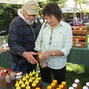 Tom Roth of Tom's Honey Jar closing a sale with Denise Paller