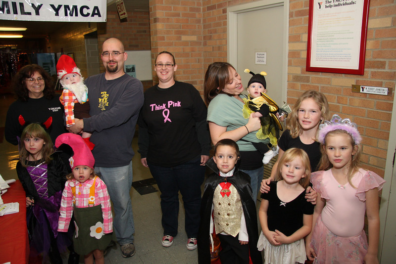 Director Brenda Hartle at far left----In purple, Karis Morales, Don Neely holding Gnome, William, Amy Morales, Rebecca Zingdle holding Bumblee Bee Cordelia, then taller girl with black dress, Mary Stark,with hands on Katie, in pink is Emily and boy Gary.  Grace Neely is girl with tall red hat !