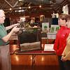 Bob Sasala. volunteer at Vermilion in Bloom Display, showing rain water flower display to Julie Riddle Somers and lLinda Biscup, Vermilion in Bloom volunteer.