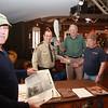 Gene Baker, assisting at the Keelhauler display, Roger Maclean, Service Ranger Vermilion River Reservation of Lorain County Metro Parks,  Bob Sasala, inspecting paddle and Bob Blair, volunteer at Keelhauler display
