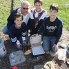 The Pajk family Jim, father with--triplets, from left to right---Jimmy, Greg and Luke, took on this renovation project.