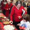 Emma and Tammy Fuller selecting some Christmas cookies after the concert.