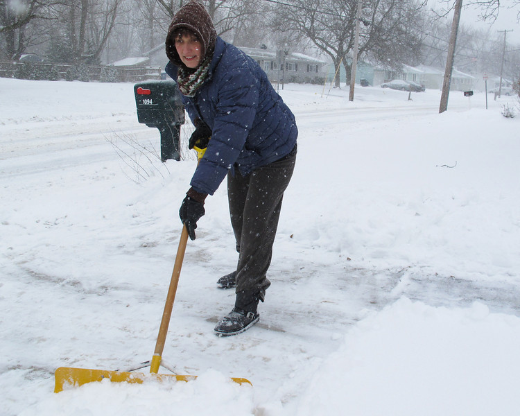 Monica Rotuno shoveling her driveway near the high school.