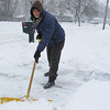 Monica Rotuno shoveling her driveway near the high school.