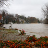 """By Riverside Drive, the water is coming up rapidly on the Vermilion River. This is taken from Willard Mercure's """"backyard."""""""