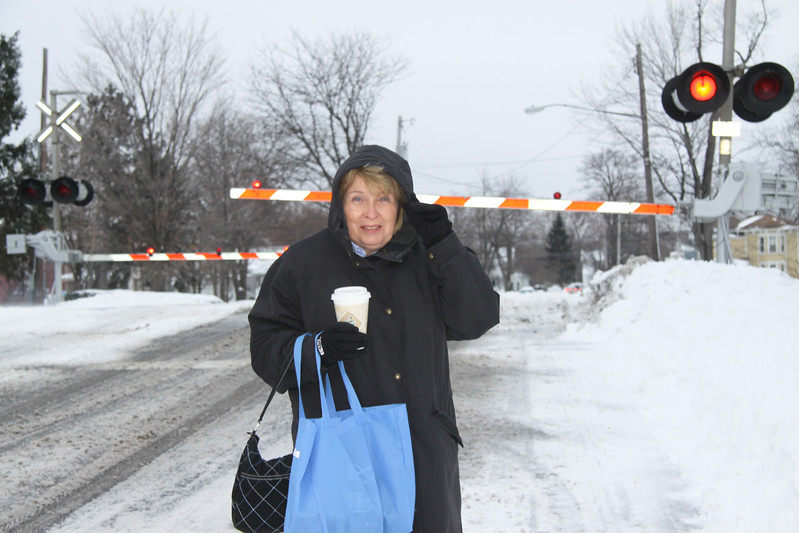 Mayor Eileen Bulan carefully trecking to her office, with a train approaching soon.
