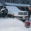 At 1490 Lexington St. Jeff Bauer is using his new snowblower.