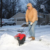 Dave Folkens also up early clearing his driveway.