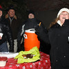 Debbie Carnahan enjoying her cookie  and hot chocolate.. Served by Jerry Masanova, J. Jones and Dave Urdzik.