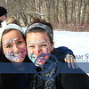 Taking a Break at the Dog Sled Demonstration from face painting at Greater Cleveland's Aquarium table in the Carriage Barn is...Kari Helms and Kayla Starta.