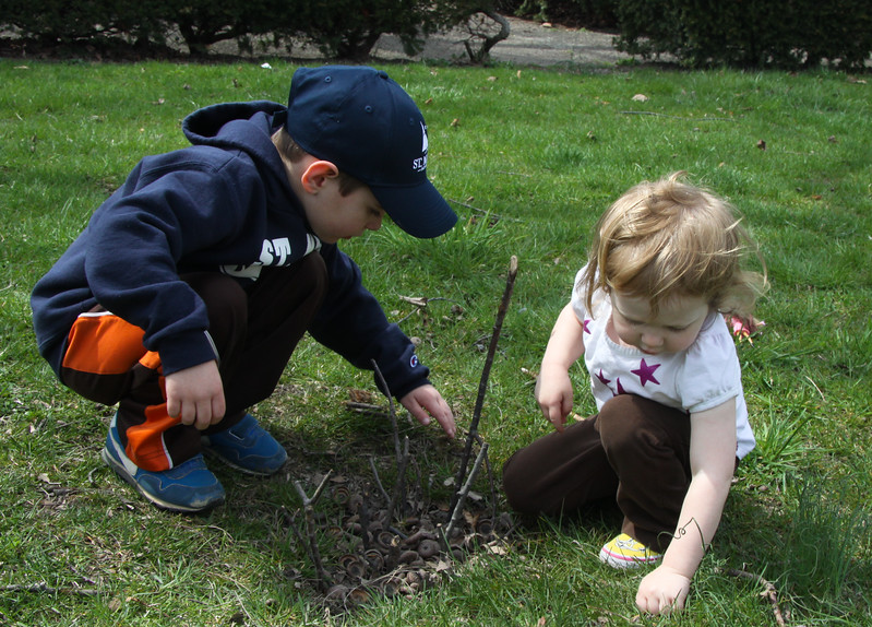 Timothy Anders and Macy Burns planting their own seedlings on the side.