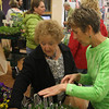 Jody Frimel giving Betsy Jaworski advice about planting.