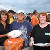 An autographed Cleveland Browns football was another hit. Betsy Wakefield, Fundraiser organizer, on right.