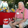 Vermilion's Goodwill ambassador and Woolly Bear Weatherman, Bill Summers, is busy selling COLD Cokes.