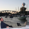 While some fishermen are checking their equipment, Tom from Dayton area, is taking it easy.<br /> NOTICE, boat in background gliding in to Mystic Belle to get Registered.