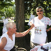 Vendor Marlene Dawson on left, talking about her Apron to Ardis Janke from Cleveland.