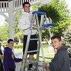 Rayn Van Curen, Vinny Ragnoni and Ryan Miller, high school volunteers at the Victory Park Gazebo