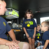 Ella, Ethan and Evan Meszaros with Fireman ?