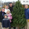 From Huron, buying a tree, is the Pitsnogle  family, Taylor, Zack, Chris and parents Aubrey and Michael.