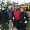 Austin and Steve Peak, take a break from selling Christmas trees with Vermilion residents and Mainstreet Vermilion volunteers, Richard and Debbie Zanglin.
