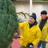 Peter Corogin and George Phillips unloading Christmas trees.