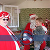 Jake Plas meets with Santa and Mrs. Claus.