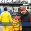 """Sandy Coe and Justo Delgado, from the  Chamber are both glad that their first Christmas Tree Ship event management is going """"per Plan.""""."""