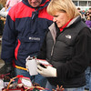 Inspecting the pine cones being sold by Venturing Troop 409 from Vermilion is Jerry and Dawn Schrenk.