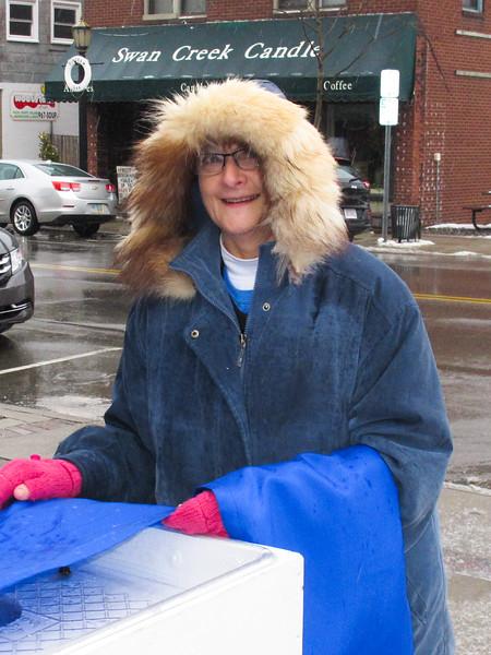 2013 Main Street Vermilion President, Sue Hunt installing wraps.