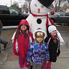 With the Snowman are Emily, Debbie Luther and Emily's sister Madison MacKrell.