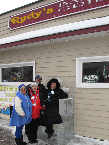 Aaron Costic in back, owner of Elegant Ice is flanked by ICE A FAIR creator, Janet Ruh, and volunteers,<br /> Jane Weaver and Carolyn Hill.