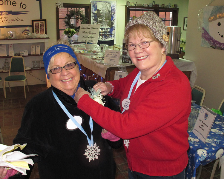 Jeannette Schaefer helping Janet with her flower.