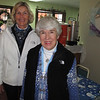 Volunteers Beth Eberhard and Jane Weaver serving hot chocolate and hot cider.