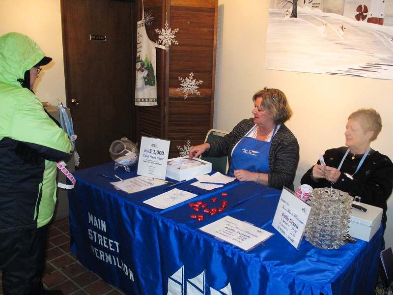 Angela Knoll buying raffle tickets for tonight's COLD HARD CASH raffle at the Boat Club.