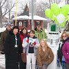 Vermilion's H R Block staff passed out balloons throughout downtown, Mike Franks, on left, is manager of the Vermilion location.Holding the balloons, is Kris Williamson and Leona Phillips is on her right.Black coat is Carolyn Hill, red coat is Debbie Caudill, green coat is Allan Caudill, baseball cap is John Hill. Exchange students, unidentified.