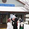 Jacki Kalvitz, Cecilia and Adam Kalvitz giving Jolly Snowman HIGH FIVE by Main Street Vermilion office.