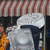 Doctor Dave Miklos observing the installation of his sculpture on Liberty St..