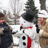 WOBL radio DJ's Big John is holding a snowball, asking Jolly, if they know each other, while Nikki Fullmer is enjoying the dialog.