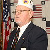 Continuation of Pearl Harbor program at the Vermilion Amvets facilities; here Dave Workman is reading the history of three support ships of Pearl Harbor that had Vermilion soldiers on them.