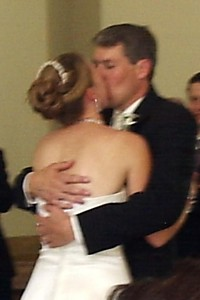Tim kisses his bride