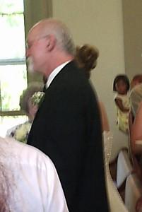 Kurt walking Marci down the aisle