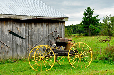 Antique Farming Wagon and the Barn Wall.