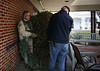 HOLLY PELCZYNSKI - BENNINGTON BANNER Don Keelan drags the donated Fraser Fir up the ramp to the Veterans Home on Monday morning in Bennington where it will be placed to the Veterans on display in the outdoor atrium.