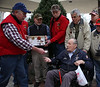 HOLLY PELCZYNSKI - BENNINGTON BANNER Marine Corps veteran Art Charron receives his military Challenge Coin for Christmas from David Zsido on Monday at the Vermont Veterans Home during the annual Don Keelan donated tree delivery. The 150 coins are given out to every veteran at the home and are made possible through donations from the Green Mountain Bull Dawg chapter of the Antique Truck Club of America.